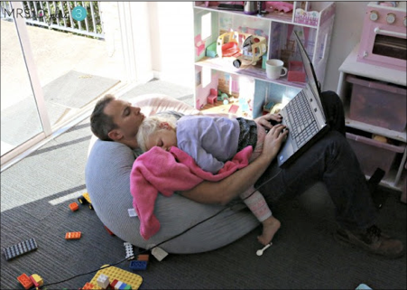 A picture containing indoor, person, child, sitting  Description automatically generated