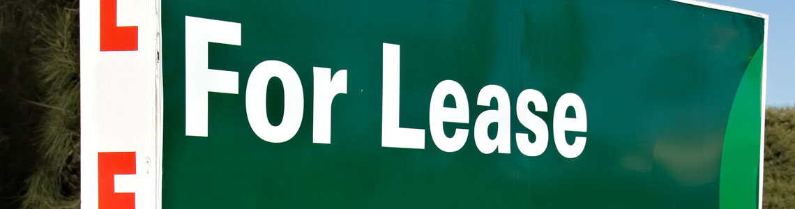 A green sign with white text  Description automatically generated