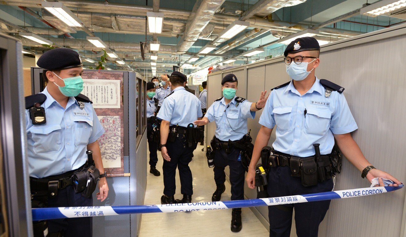 Hong Kong police cordon off an office area of the Apple Daily newspaper after arresting its founder Jimmy Lai on suspicion of foreign collusion. Photo: Handout